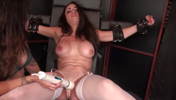 Strapped brunette is at the mercy of her lesbian mistress