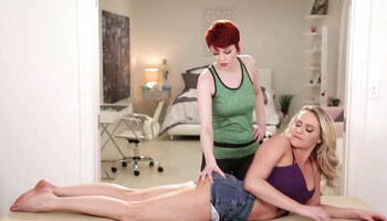 Redhead gives a relaxing massage to her blonde girlfriend