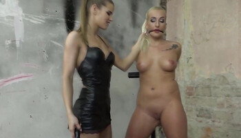 Naked blonde is tied and tortured by dominatrix girl
