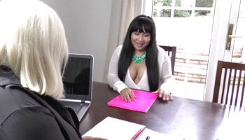 Two buxom MILFs have lesbian sex in an office