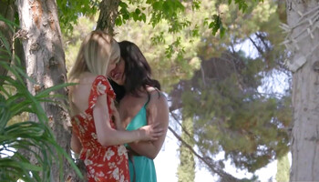 Lovely girl-on-girl threeway sex in a public park