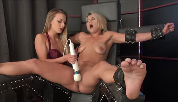 Magic wand treatment for a tied up lesbian babe