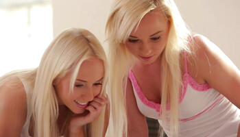 Dazzling blondes are enjoying the taste of each other's cherry