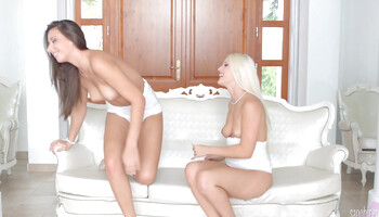 Brunette is sitting on blonde's face while receiving cunnilingus