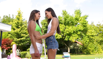 Lesbian lovemaking session in the swimming pool between two girls