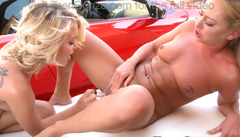 Video of a red roadster and two blonde lesbians
